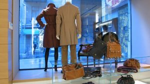 An apparel store where in some clothing and some baggage on display